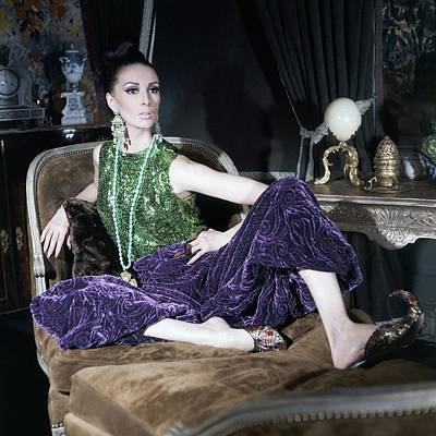 A Model Wearing A Glittery Top And Velvet Pants Poster