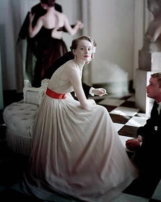 A Model Wearing A Harry Keiser Dress Poster