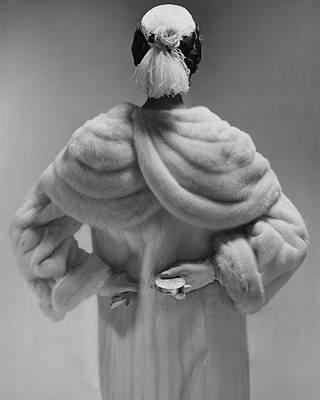 A Model Wearing A Mink Coat Poster
