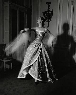 A Model Wearing A Polka Dot Dress Poster by John Rawlings