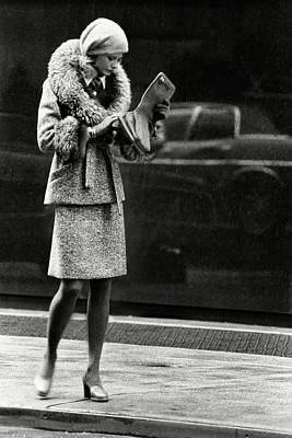 A Model Wearing A Seymour Fox Suit Poster