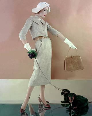 A Model Wearing A Tweed Jacket And Skirt Poster by Karen Radkai