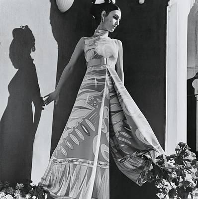 A Model Wearing An Evening Wear Poster