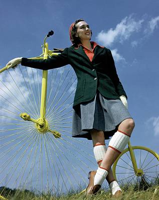 A Model With An Old-fashioned Bicycle Poster