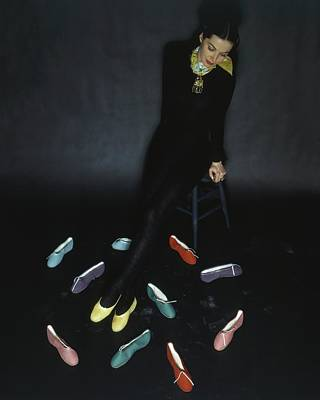 A Model With Footlights Ballet Slippers Poster by John Rawlings