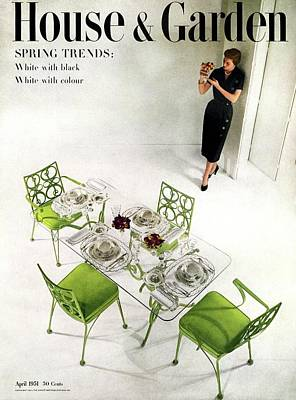 A Patio Table With A Model Standing Behind Poster by Herbert Matter
