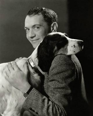 A Portrait Of John Held Jr. Hugging A Dog Poster by Nicholas Muray