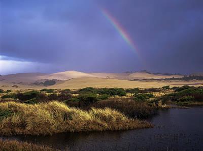 A Rainbow Over The Umpqua Dunes, Oregon Poster by Robert L. Potts