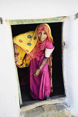 A Rajput Woman Leaving A Building Near Poster by Alan Williams