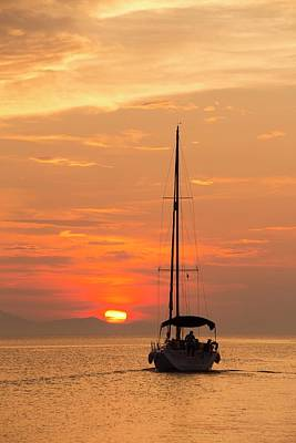 A Sailing Boat At Sunset Poster by Ashley Cooper