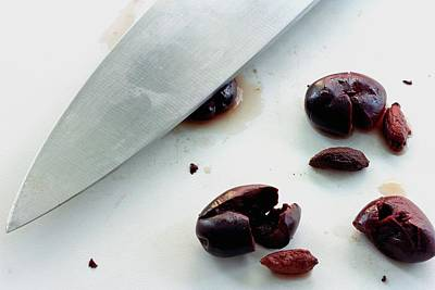 A Sharp Knife And A Group Of Olives Poster