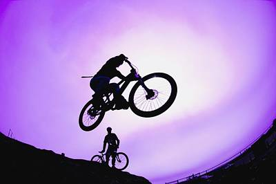 A Stunt Cyclist Silhouette Poster by Corey Hochachka
