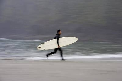 A Surfer, Running With Board Along The Poster