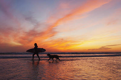 A Surfer Walks In Shallow Water With Poster
