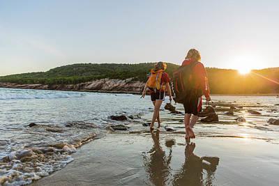 A Teenage Boy And Girl Walk On Sand Poster