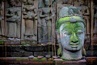 A Terra Cotta Head Of Buddha Sits Poster by Matt Brandon