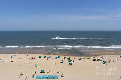 A Touring Speedboat Passes By Shore In Ocean City Maryland Poster