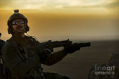 A U.s. Air Force Pararescueman Provides Poster by Stocktrek Images