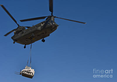 A U.s. Army Ch-47 Chinook Carries Poster by Stocktrek Images