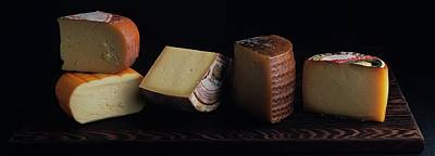 A Variety Of Cheese On A Cutting Board Poster by Romulo Yanes