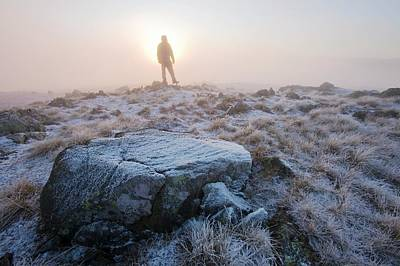 A Walker On The Summit Of Caudale Moor Poster by Ashley Cooper