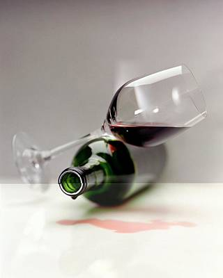 A Wine Bottle And A Glass Of Wine Poster