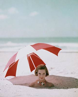 A Woman Buried In Sand At A Beach Poster by Richard Rutledge
