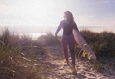 A Woman Carries Her Surfboard Poster by Ben Welsh