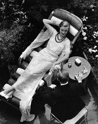 A Woman In A Chiffon Tea Gown In A Chaise Longue Poster