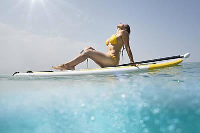 A Woman In A Yellow Bikini Sits Poster