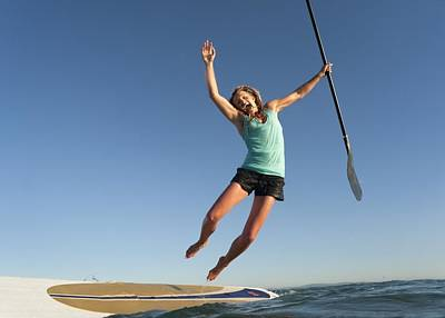 A Woman Jumps Into The Water Off A Surf Poster by Ben Welsh