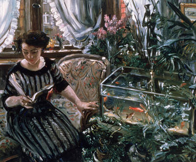 A Woman Reading Near A Goldfish Tank Poster