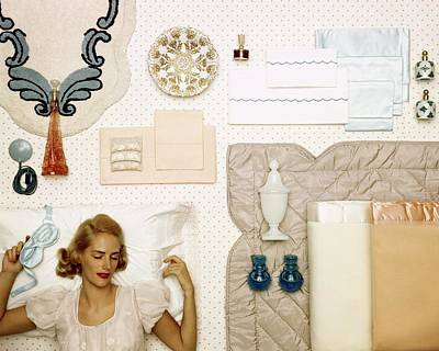 A Woman Sleeping Next To An Assorted Range Poster by Geoffrey Baker