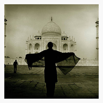 A Woman Stands Near The Famous Taj Poster