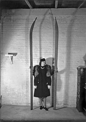 A Woman With Nine Foot Skis Poster by Underwood Archives