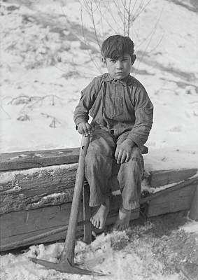 A Young Boy Digging Coal Poster