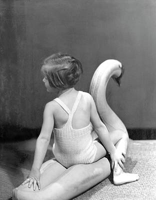 A Young Girl Sitting On A Toy Swan Poster