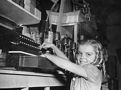 A Young Girl Working Poster by Underwood Archives