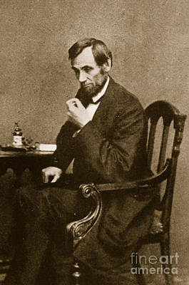 Abraham Lincoln Sitting At Desk Poster by Mathew Brady