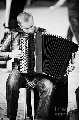 Accordion Player Playing Street Musician In Rynek Glowny Town Square Krakow Poster by Joe Fox