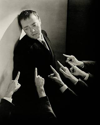 Actor Peter Lorre Posing Against A Wall Poster