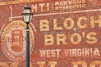 Advertisements On Side Of Building Poster by William Sutton