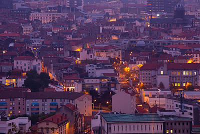 Aerial View Of Building Lit Up At Dusk Poster