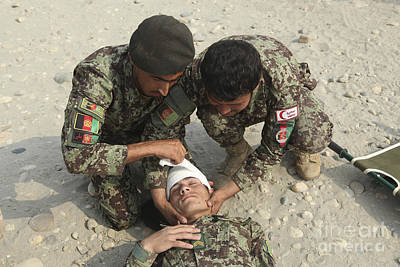 Afghan National Army Soldiers Put Poster by Stocktrek Images