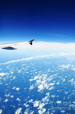 Airplane Wing Against Blue Sky Horizon Poster