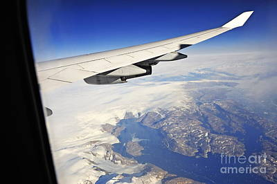Airplane Wing Over Snowy And Rocky Coastline Poster by Sami Sarkis
