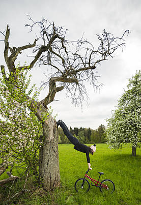 Amazing Stretching Exercise - Bmx Flatland Rider Monika Hinz Uses A Tree Poster by Matthias Hauser