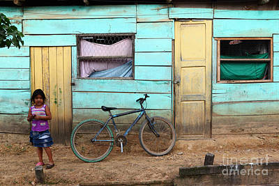 Amazon Street Scene Poster by James Brunker