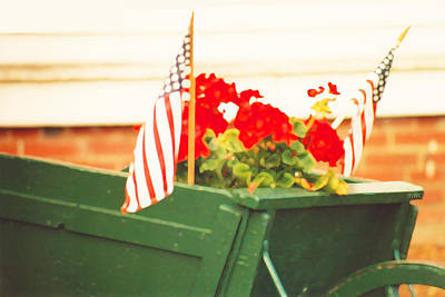 American Flags And Geraniums In A Wheelbarrow Two Poster by Marian Cates