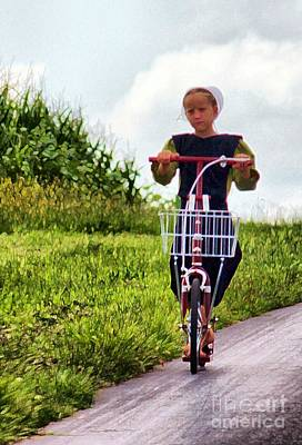 Amish Girl Scooting In Lancaster Pennsylvania Usa Poster by Polly Peacock